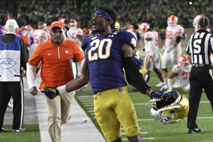 Notre Dame safety Shaun Crawford (20) celebrates after Notre Dame defeated Clemson 47-40 in two overtimes during an NCAA college football game Saturday, Nov. 7, 2020, in South Bend, Ind. (Matt Cashore/Pool Photo via AP)