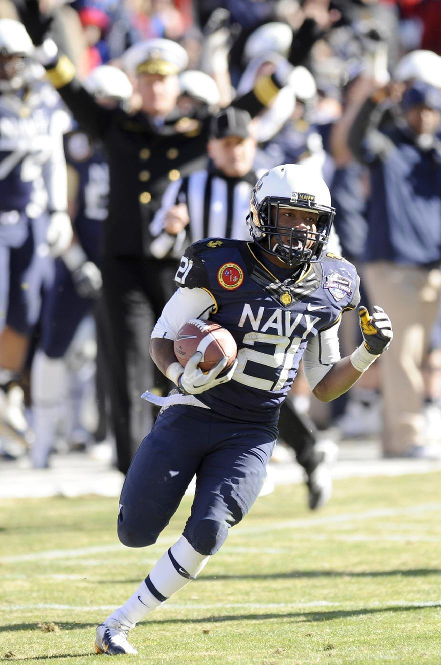 Navy Midshipmen running back DeBrandon Sanders (21) funs upfield for a touchdown in the second half during the Armed Forces Bowl NCAA college football game, Monday, Dec. 30, 2013, in Fort Worth. Navy won 24-6. (AP Photo/Matt Strasen)