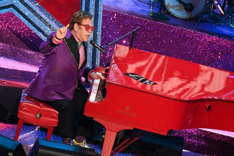 Elton John is performing despite a hip injury that forced him to postpone the rest of his farewell tour dates for this year. (AFP/Mark RALSTON)