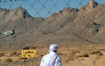 This file photo from February 2010 shows the entrance of the former French nuclear bomb test site at Ain Ekra