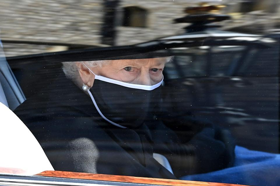 Queen Elizabeth II arrives for the funeral of Prince Philip, the Duke of Edinburgh, at Windsor Castle Saturday.