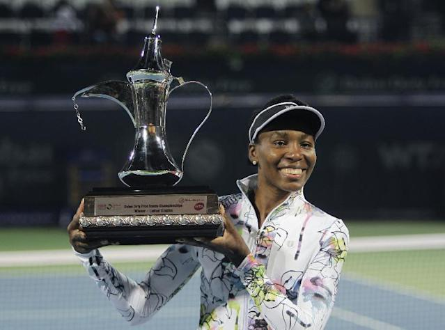 Venus Williams of the U.S. holds the trophy after she beat Alize Cornet of France during the final match of Dubai Duty Free Tennis Championships in Dubai, United Arab Emirates, Saturday, Feb. 22, 2014. (AP Photo/Kamran Jebreili)