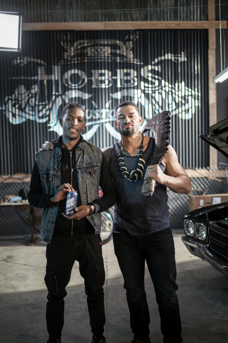 "Evans Alexandre & Roman Reigns on set of ""How Do You Open A Can of Whup Ass?"""