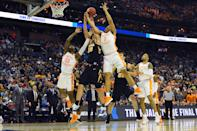 <p>Luka Garza #55 of the Iowa Hawkeyes fights for a rebound against Jordan Bowden #23 and Grant Williams #2 of the Tennessee Volunteers in the second round of the 2019 NCAA Men's Basketball Tournament held at Nationwide Arena on March 24, 2019 in Columbus, Ohio. (Photo by Jamie Schwaberow/NCAA Photos via Getty Images) </p>