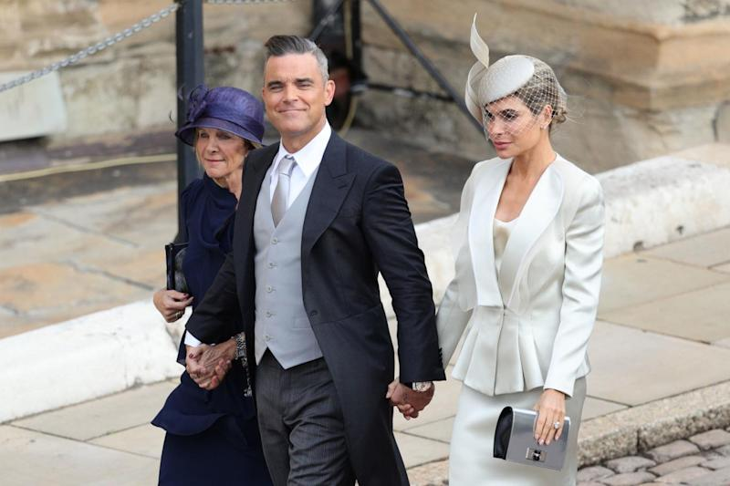 Mocked: Robbie Williams with his wife Ayda Field and mother-in-law Gwen Field (PA)