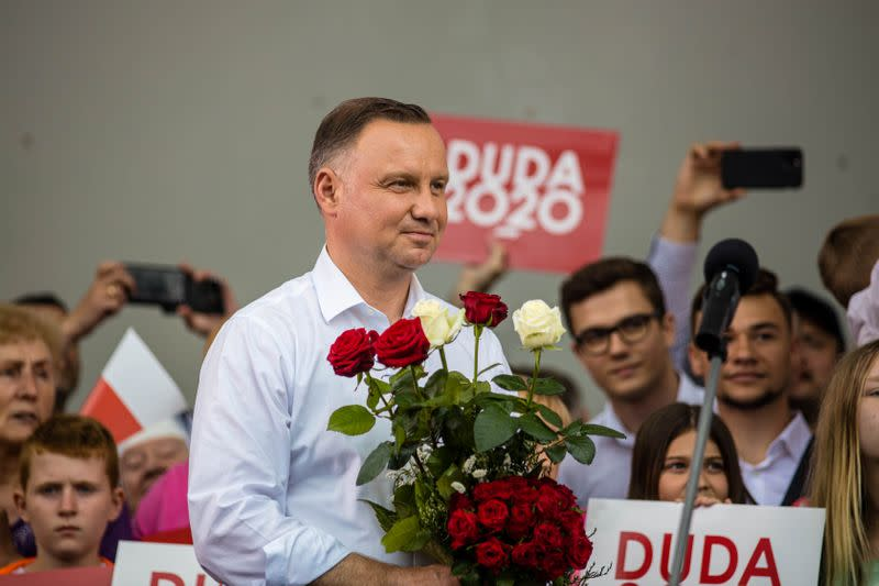 Polish President Andrzej Duda smiles during his election rally in Kwidzyn