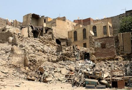Wreckage of old houses are seen in the Darb al-Labbana hillside neighbourhood in Cairo