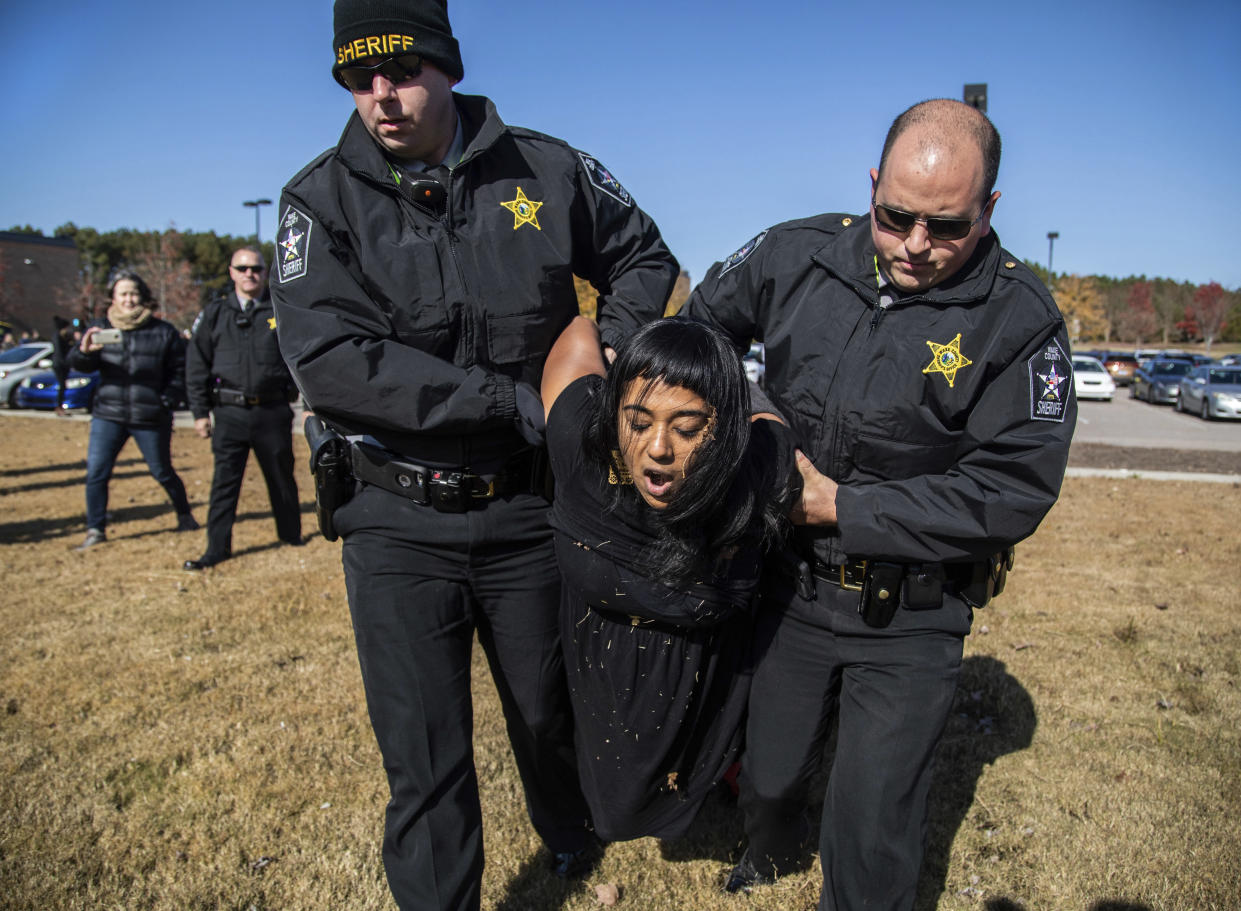 A demonstrator is arrested after Samuel Oliver-Bruno, 47, an undocumented Mexican national, was arrested after arriving at an appointment with immigration officials, in Morrisville, N.C., last year. (Photo: Travis Long/The News & Observer via AP)