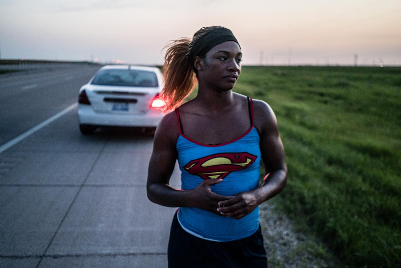 "<p>Claressa ""T-Rex"" Shields, 20, stops along the highway somewhere in Kansas, June 2015. She is driving from her hometown of Flint, MIch., to the Olympic Training Center in Colorado Springs, Colo., where she is moving. Its the first time she has ever lived outside of Flint. (Photograph by Zackary Canepari) </p>"