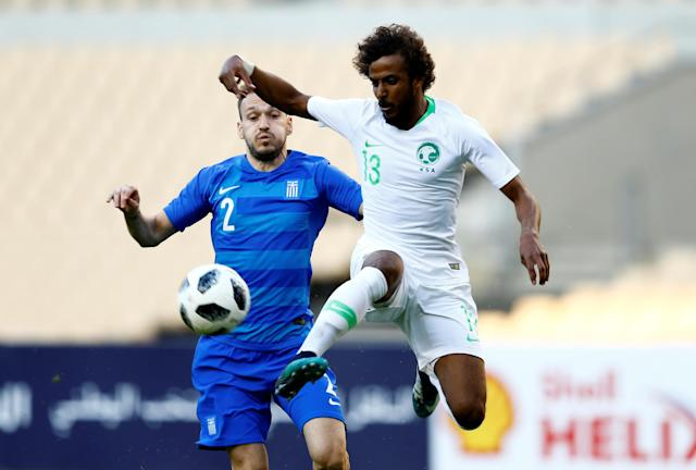 Soccer Football - International Friendly - Saudi Arabia v Greece - Estadio de La Cartuja, Seville, Spain - May 15, 2018 Saudi Arabia's Yasser Al-Shahrani in action with Greece's Michail Bakakis REUTERS/Marcelo Del Pozo