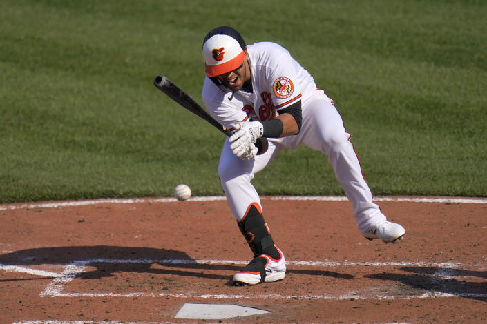 Baltimore Orioles' Rio Ruiz reacts after being hit by a pitch from Boston Red Sox starting pitcher Eduardo Rodriguez during the fourth inning of a baseball game, Thursday, April 8, 2021, on Opening Day in Baltimore. Ruiz swung on the pitch and wasn't awarded first base. (AP Photo/Julio Cortez)