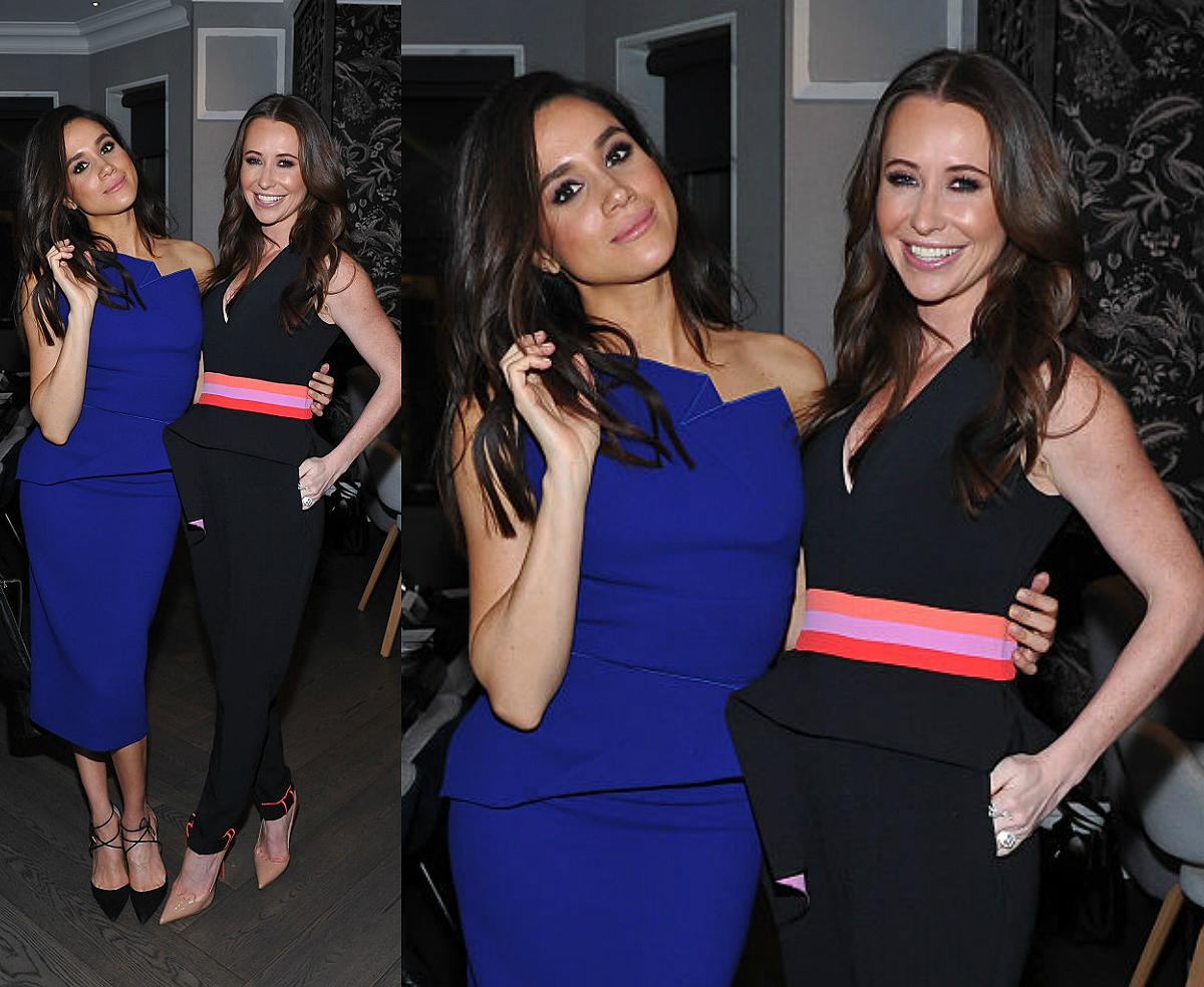 Meghan Markle and Jessica Mulroney attend the Equinox Yorkville Dinner at Kasa Moto, Nov. 23, 2015 in Toronto. According to Cobb, the way Markle is holding her hair suggests that she's being playful with the camera. (Photo: Getty)