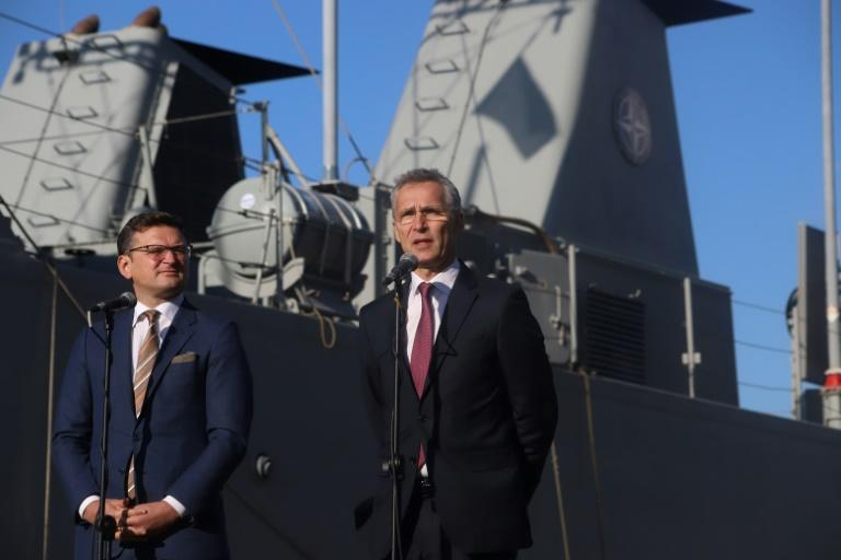 Ukraine's Deputy Prime Minister Dmytro Kuleba (left) joins NATO Secretary General Jens Stoltenberg at the Black Sea port of Odessa in October 2019