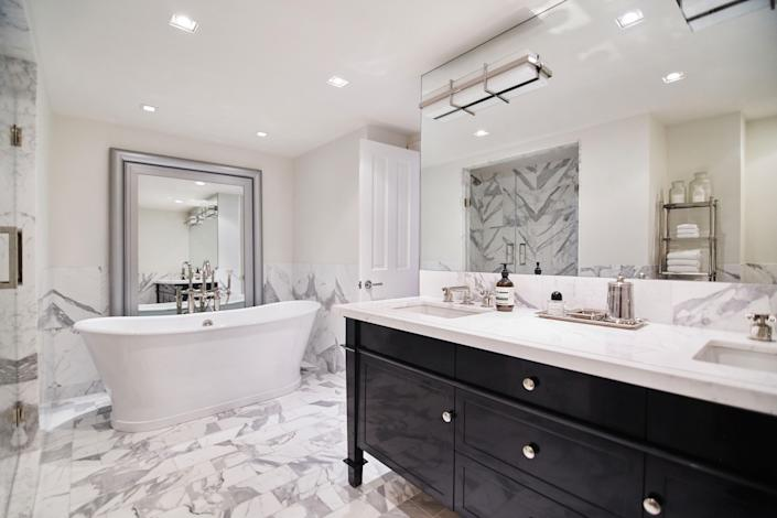 To open up another bathroom, Blinken added a tub with a mirror behind it. She also painted the walls white.