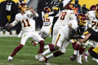 Washington Football Team quarterback Alex Smith (11) throws a pass during the second half of an NFL football game against the Pittsburgh Steelers in Pittsburgh, Monday, Dec. 7, 2020. (AP Photo/Barry Reeger)