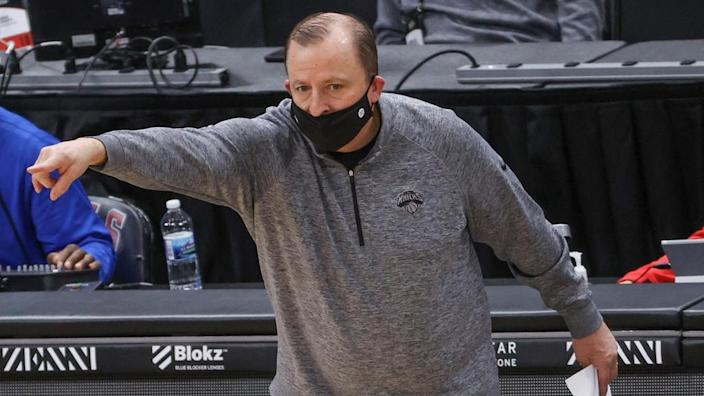 Tom Thibodeau pointing in grey pullover, no players visible