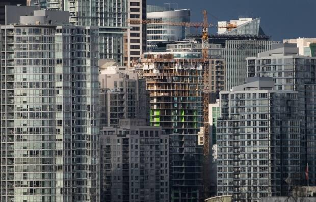 A condo tower under construction is pictured in downtown Vancouver in February 2020.