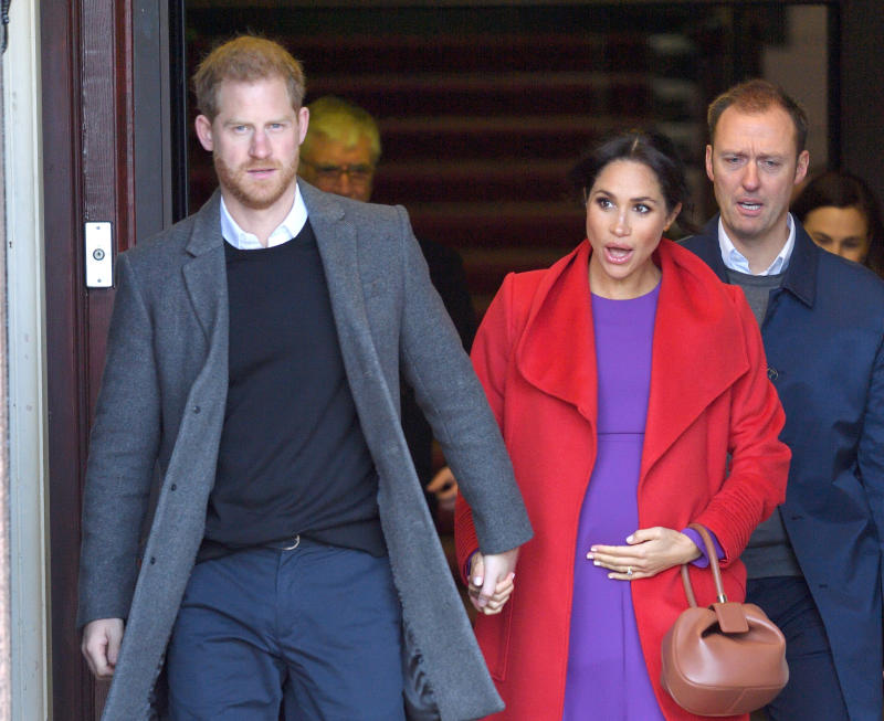 BIRKENHEAD, UNITED KINGDOM - JANUARY 14: Prince Harry, Duke of Sussex and Meghan, Duchess of Sussex meet members of the public during a visit of Birkenhead at Hamilton Square on January 14, 2019 in Birkenhead, UK. (Photo by Karwai Tang/WireImage)