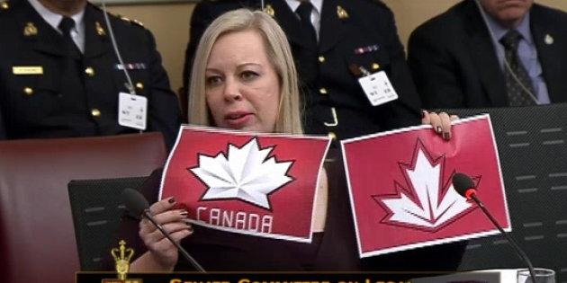 Sen. Denise Batters holds up two examples of logos used by Hockey Canada. The Conservative senator thinks young people will conflate the two, dulling warning messages on regulated cannabis products.