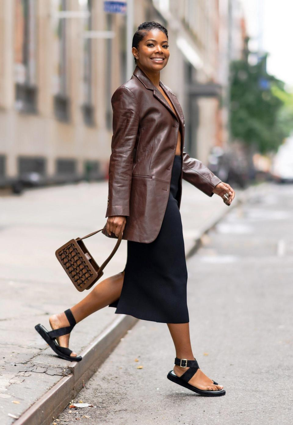 <p>Gabrielle Union pairs a stylish leather Sportmax jacket with a black skirt as she heads out in N.Y.C. on July 25.</p>