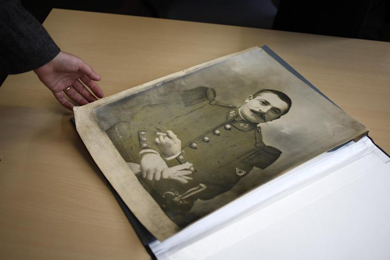 "In this photo taken Saturday Nov. 16, 2013, a soldier's photograph dating from World War I sits on a table, in Lille northern France. Paris' National Library is one of dozens of collection points across France that opened their doors from November 9 to 16 for the ""Grande Collecte."" Donors were invited to tell the stories behind their mementos, which the library's experts used to annotate the entries in the archive. Contributors watched as the library's technical staff digitized their items before returning them to the donor. (AP Photo/Michel Spingler)"
