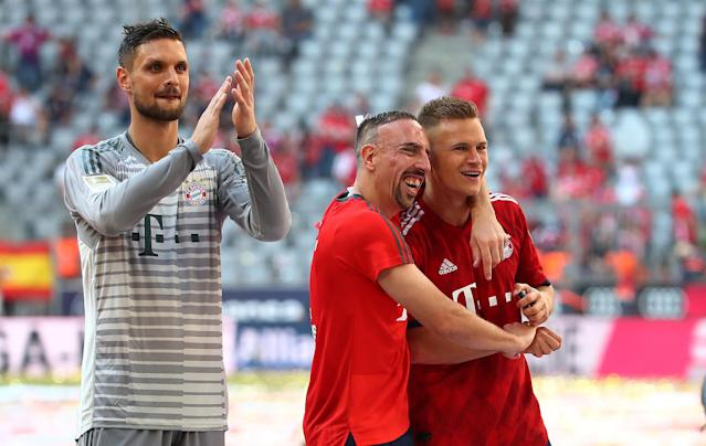 Soccer Football - Bundesliga - Bayern Munich v VfB Stuttgart - Allianz Arena, Munich, Germany - May 12, 2018 Bayern Munich's Sven Ulreich, Franck Ribery and Joshua Kimmich as they celebrate winning the Bundesliga REUTERS/Michael Dalder DFL RULES TO LIMIT THE ONLINE USAGE DURING MATCH TIME TO 15 PICTURES PER GAME. IMAGE SEQUENCES TO SIMULATE VIDEO IS NOT ALLOWED AT ANY TIME. FOR FURTHER QUERIES PLEASE CONTACT DFL DIRECTLY AT + 49 69 650050