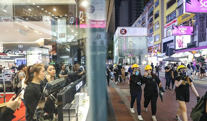 Protesters on Lockhart Road in Causeway Bay on August 4 after a rally at Belcher Bay Park in Kennedy Town. Photo: Sam Tsang