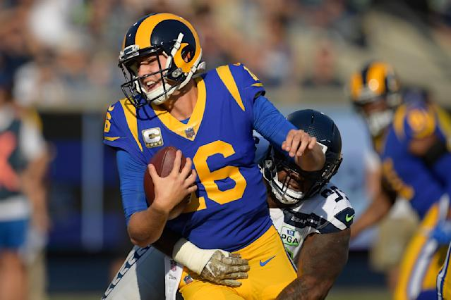 Los Angeles Rams quarterback Jared Goff gets sacked by Seattle Seahawks defensive end Quinton Jefferson during the first half in an NFL football game Sunday, Nov. 11, 2018, in Los Angeles. (AP Photo/Mark J. Terrill)