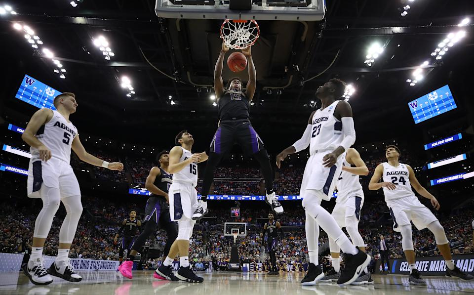 <p>Noah Dickerson #15 of the Washington Huskies dunks against Abel Porter #15 and Neemias Queta #23 of the Utah State Aggies during the first half of the game in the first round of the 2019 NCAA Men's Basketball Tournament at Nationwide Arena on March 22, 2019 in Columbus, Ohio. </p>
