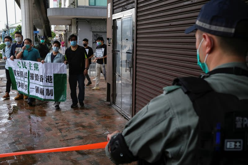 Activists march against new security laws, near China's Liaison Office, in Hong Kong