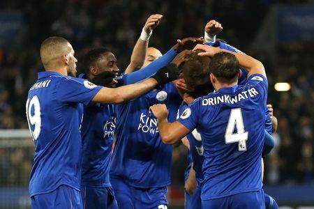 Leicester City's Jamie Vardy celebrates scoring their second goal with team mates