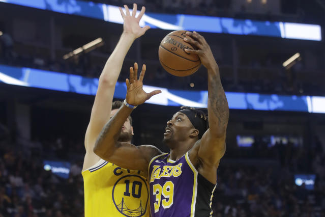 Los Angeles Lakers center Dwight Howard (39) shoots against Golden State Warriors forward Dragan Bender during the first half of an NBA basketball game in San Francisco, Thursday, Feb. 27, 2020. (AP Photo/Jeff Chiu)