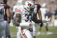 FILE - In this Sept. 21, 2019, file photo, Auburn linebacker K.J. Britt (33) reacts after making a stop against Texas A&M during the first half of an NCAA college football game, in College Station, Texas. Britt was selected to The Associated Press All-Southeastern Conference football team, Monday, Dec. 9, 2019.(AP Photo/Sam Craft, File)