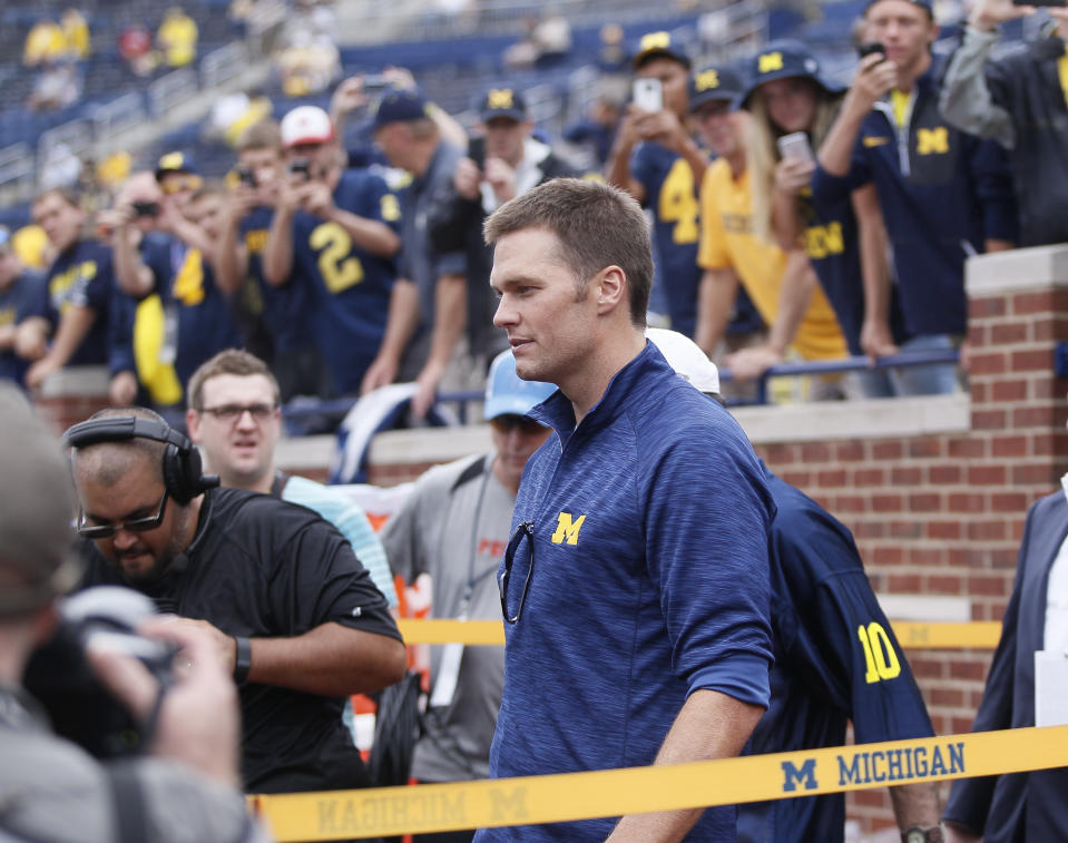 Tom Brady left Michigan as a forgotten sixth-round pick hoping to make a roster. He returned years later as Tom Brady. (Duane Burleson/Getty Images)