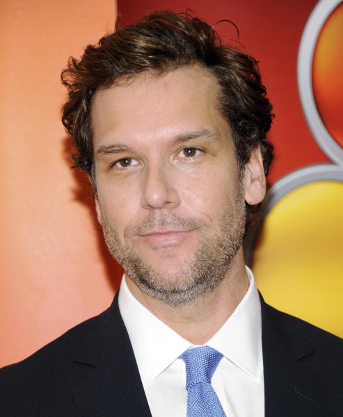 FILE - In this May 14, 2013 file photo, comedian Dane Cook arrives for an event at Radio City Music Hall in New York. Cook is under fire for his decision not to let organizers stream or televise his set at a benefit concert Thursday night, May 30, 2013, for victims of the Boston Marathon bombings. (AP Photo/Evan Agostini, File)