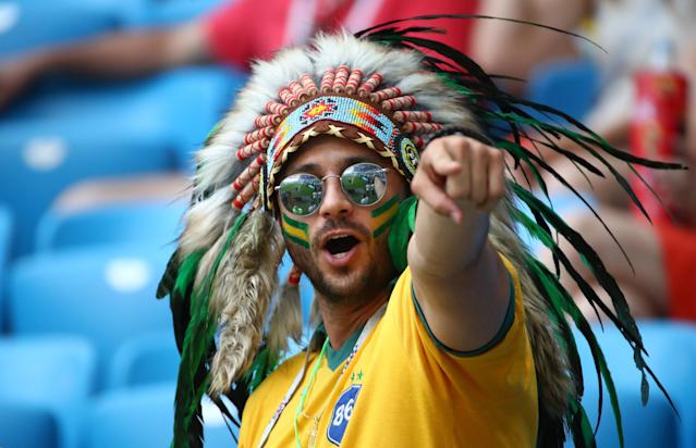 <p>Brazil fan before the match REUTERS/Michael Dalder </p>