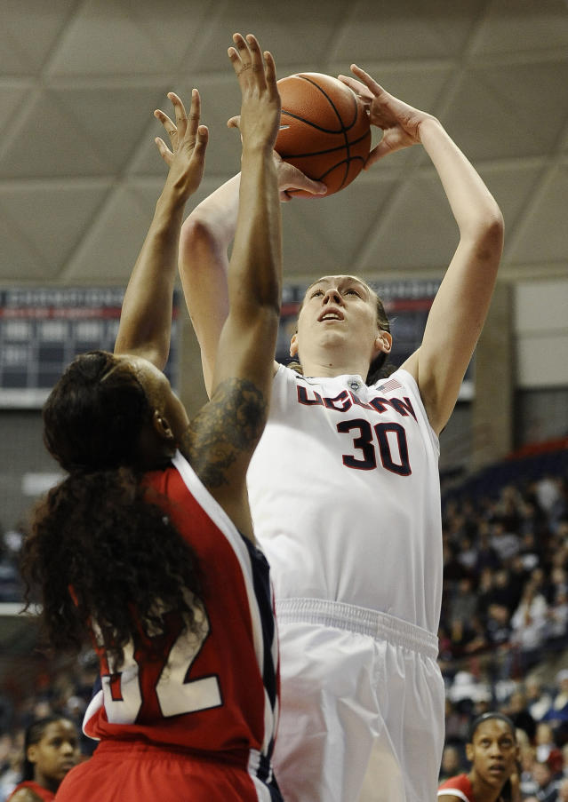Connecticut's Breanna Stewart shoots over Houston's Te'onna Campbell, left, during the first half of an NCAA college basketball game, Tuesday, Jan. 7, 2014, in Storrs, Conn. (AP Photo/Jessica Hill)