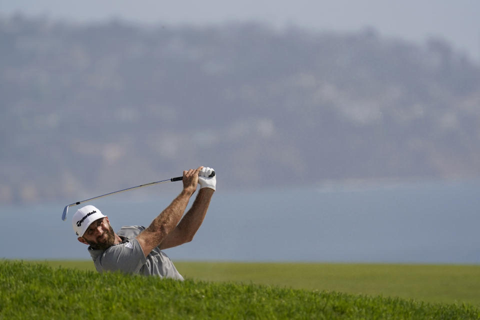 Dustin Johnson hits from the fourth fairway during the first round of the U.S. Open Golf Championship, Thursday, June 17, 2021, at Torrey Pines Golf Course in San Diego. (AP Photo/Gregory Bull)
