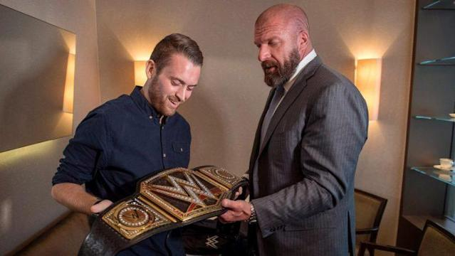 Charlie Guenigault presented with his own title belt by Triple H. (Photo courtesy of WWE)