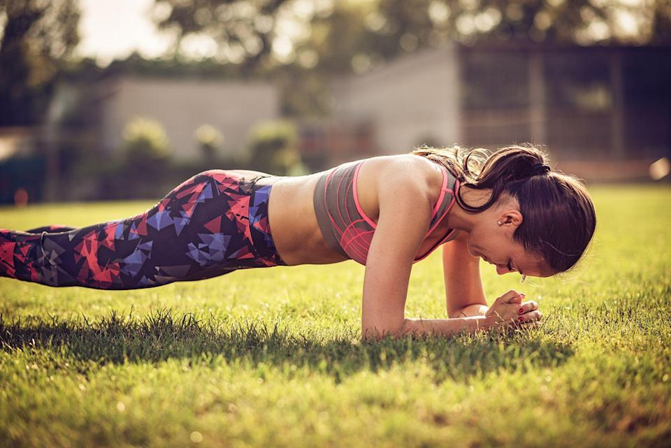 """<p>When many people think of losing weight, one of the first things that comes to mind is getting a totally toned and taut tummy. After all, who <em>doesn't </em>want to be able to slip into a pair of jeans without having to deal with a muffin top? Plus, losing <a href=""""https://www.prevention.com/weight-loss/a20458064/new-research-on-how-to-lose-belly-fat/"""" rel=""""nofollow noopener"""" target=""""_blank"""" data-ylk=""""slk:belly fat"""" class=""""link rapid-noclick-resp"""">belly fat</a> is a surefire way to improve your health: <a href=""""https://www.sciencedirect.com/science/article/pii/S0735109716347805"""" rel=""""nofollow noopener"""" target=""""_blank"""" data-ylk=""""slk:Research"""" class=""""link rapid-noclick-resp"""">Research</a> links a larger waist size to <a href=""""https://www.prevention.com/health/health-conditions/g26253924/weird-heart-disease-risk-factors/"""" rel=""""nofollow noopener"""" target=""""_blank"""" data-ylk=""""slk:heart disease"""" class=""""link rapid-noclick-resp"""">heart disease</a>, <a href=""""https://www.prevention.com/health/diabetes/"""" rel=""""nofollow noopener"""" target=""""_blank"""" data-ylk=""""slk:diabetes"""" class=""""link rapid-noclick-resp"""">diabetes</a>, and even some cancers. That said, we hate to break it to you, but doing hundreds of crunches every day isn't the best way to lose belly fat. In fact, exercises that promote spot reduction just don't exist. </p><p>""""Spot reduction isn't a viable approach to losing belly fat,"""" explains fitness trainer and nutrition expert <a href=""""https://www.cultivatebycorey.com/"""" rel=""""nofollow noopener"""" target=""""_blank"""" data-ylk=""""slk:Corey Phelps"""" class=""""link rapid-noclick-resp"""">Corey Phelps</a>, creator of the <a href=""""https://www.cultivatebycorey.com/cultivate365/"""" rel=""""nofollow noopener"""" target=""""_blank"""" data-ylk=""""slk:Cultivate by Corey Fitness Program"""" class=""""link rapid-noclick-resp"""">Cultivate by Corey Fitness Program</a>. """"But there are some great core-focused exercises that will torch fat all over the body, resulting in a strong and more chiseled core."""" </p><p><strong>RELATED: Join """