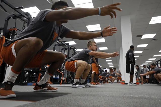 Texas Longhorns' Sam Ehlinger (left center) and teammates work out Wednesday Sept. 4, 2019 in Austin, Tx. ( Photo by Edward A. Ornelas )