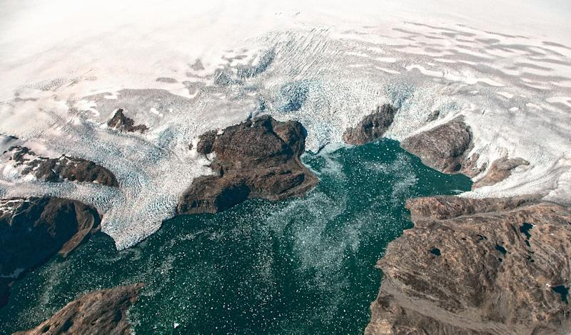 Greenland contains enough frozen water to lift oceans by about seven metres (23 feet), though experts disagree on the global warming threshold for irreversible melting, and how long that would take once set in motion (AFP Photo/Jeremy HARBECK)