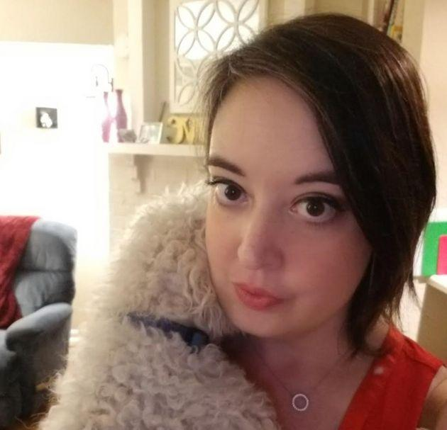 The author hugs one of her dogs in her apartment.