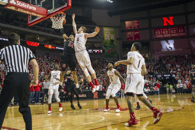 Nebraska's James Palmer Jr. (24) makes a lay up against Maryland's Kevin Huerter (4) during the first half of an NCAA college basketball game in Lincoln, Neb. Tuesday, Feb. 13, 2018.(AP Photo/John Peterson)