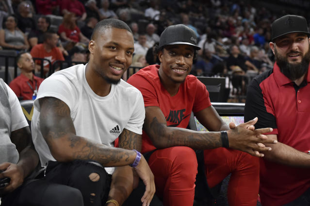 "<a class=""link rapid-noclick-resp"" href=""/nba/players/5012/"" data-ylk=""slk:Damian Lillard"">Damian Lillard</a> and <a class=""link rapid-noclick-resp"" href=""/nba/players/4614/"" data-ylk=""slk:DeMar DeRozan"">DeMar DeRozan</a> watched the <a class=""link rapid-noclick-resp"" href=""/wnba/teams/sas"" data-ylk=""slk:Las Vegas Aces"">Las Vegas Aces</a> take on the <a class=""link rapid-noclick-resp"" href=""/wnba/teams/con"" data-ylk=""slk:Connecticut Sun"">Connecticut Sun</a> on Saturday. (Photo by David Becker/NBAE via Getty Images)"