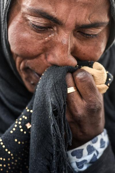 A displaced Iraqi woman wipes away tears at the Hasan Sham camp for internally displaced people east of Mosul on June 10, 2017 (AFP Photo/MOHAMED EL-SHAHED)