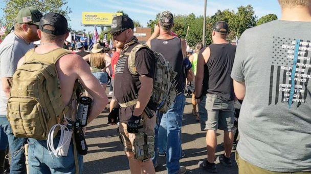 PHOTO: Aaron Danielson, center wearing a black T-shirt and a backpack, is pictured at a pro-Trump rally hours before he was killed in Portland, Ore., Aug. 29, 2020. (Mark Baker/The New York Times via Redux, FILE)