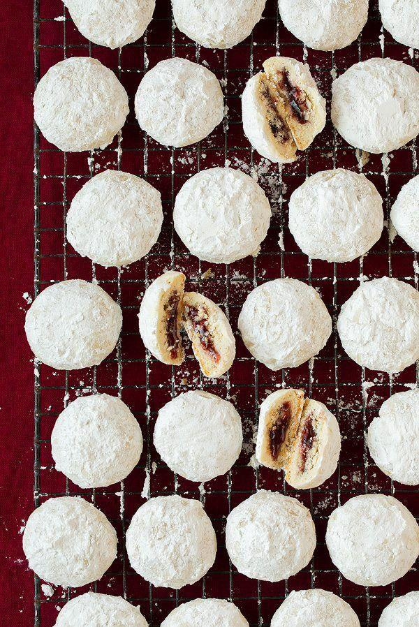 """<p>Elevate your favorite snowball cookie with this recipe that uses tasty raspberry jam as a surprise in the middle.</p><p><strong>Get the recipe at <a href=""""https://www.cookingclassy.com/raspberry-almond-snowball-cookies/"""" rel=""""nofollow noopener"""" target=""""_blank"""" data-ylk=""""slk:Cooking Classy"""" class=""""link rapid-noclick-resp"""">Cooking Classy</a>.</strong></p><p><strong><strong><a class=""""link rapid-noclick-resp"""" href=""""https://www.amazon.com/Circulon-Nonstick-Bakeware-2-Piece-Gray/dp/B0093JW3E0/ref=sxin_5_ac_d_pm?tag=syn-yahoo-20&ascsubtag=%5Bartid%7C10050.g.647%5Bsrc%7Cyahoo-us"""" rel=""""nofollow noopener"""" target=""""_blank"""" data-ylk=""""slk:SHOP BAKING SHEETS"""">SHOP BAKING SHEETS</a></strong><br></strong></p>"""