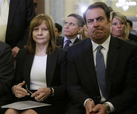 General Motors CEO Barra and GM Executive Vice President Reuss await Barra's testimony before the Senate Commerce and Transportation Consumer Protection, Product Safety and Insurance subcommittee in Washington
