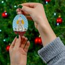 <p>Their tree will look a little more festive with this <span>Mother Moira Ceramic Ornament</span> ($9).</p>